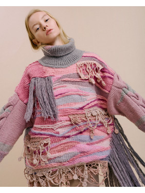 Sweater with fringing and braided sleeves