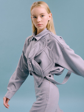 Houndstooth suit with a flower detail